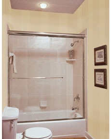 through the clear glass semi frameless sliding shower door enclosure.